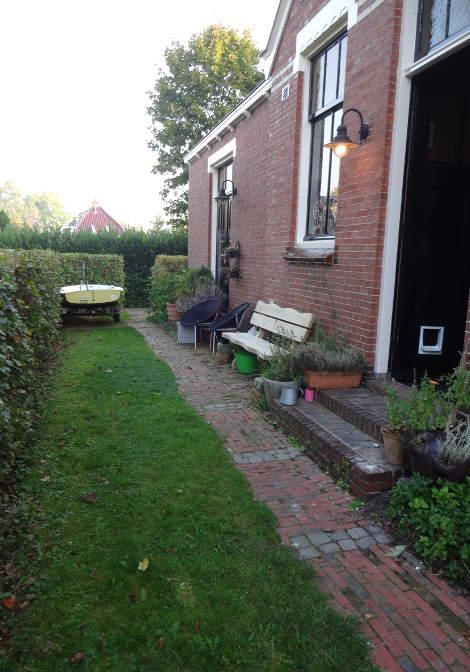 Cre ren van een fijne zitplek hoveniersbedrijf duizendknoop - Creeren van een tuin allee ...